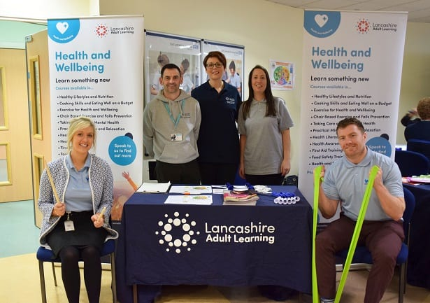 Health and wellbeing stand with staff promoting taking 5 for physical and mental wellbeing