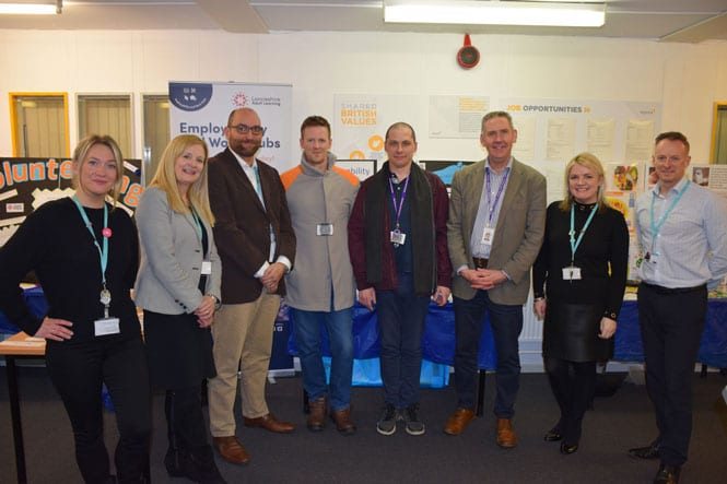Members of Lancashire Adult Learning staff alongside staff members from HM Kirkham prison to show their partnership to support prisoners' on their release date